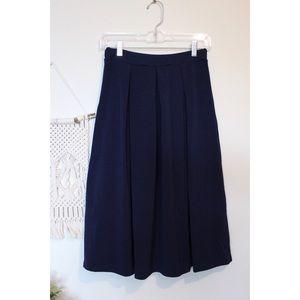 Navy blue pleated midi skirt